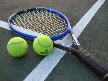 tennis-racket-and-balls-594824261